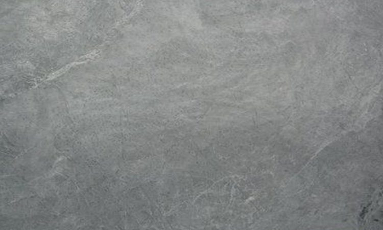 Soapstone Silver. Classic soapstone,grey color with minimal veining but with movement. This is a soft soapstone 2.5 on Mohs scale. When oiled turn dark grey and show the movement. Large size slabs available[130''x75'']ideal for Island or large  kitchen top with no seams.