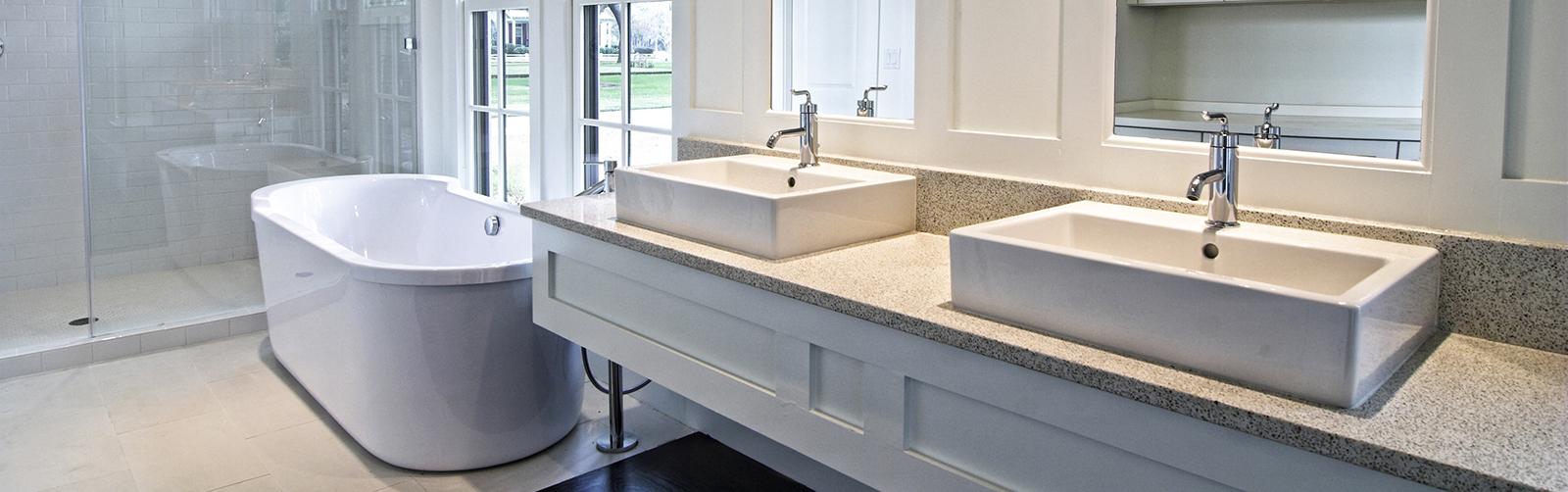 modern spacious white bathroom with dark wood floors