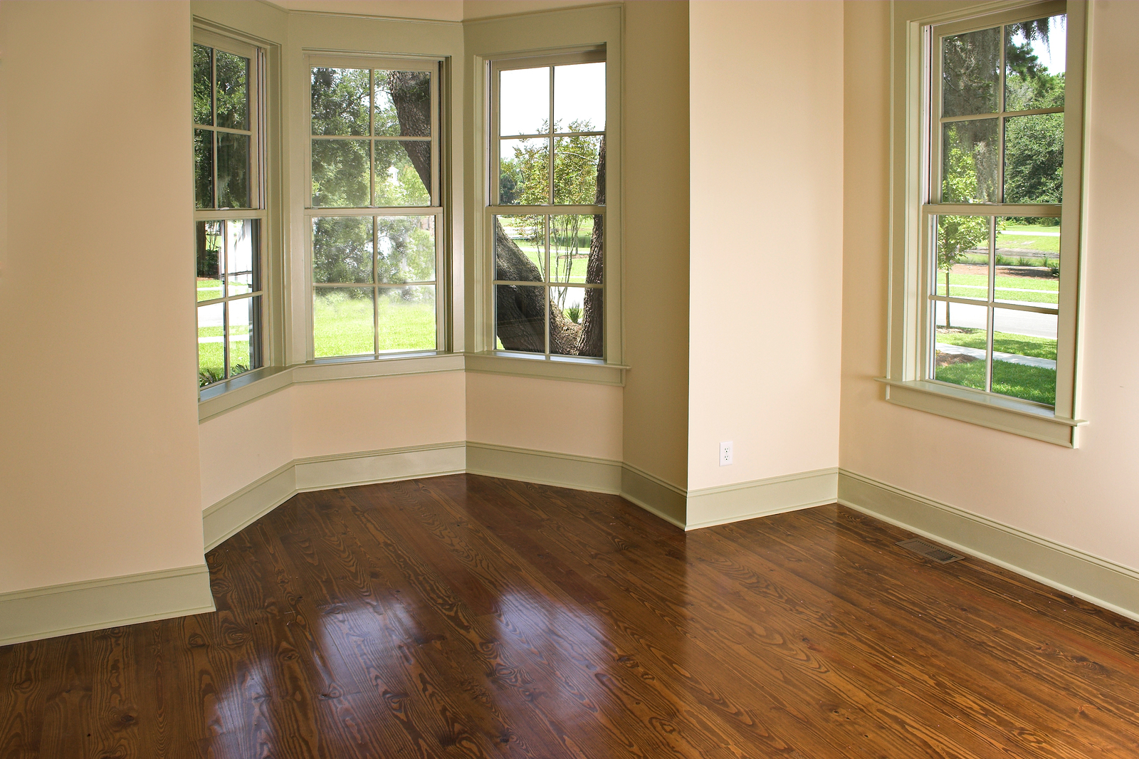 unfurnished bedroom with bay window looking over the trees