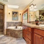 Lovely master bathroom with stone floor and large shower.