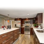 Large kitchen with white counter tops and a big island. ** Note: Soft Focus at 100%, best at smaller sizes
