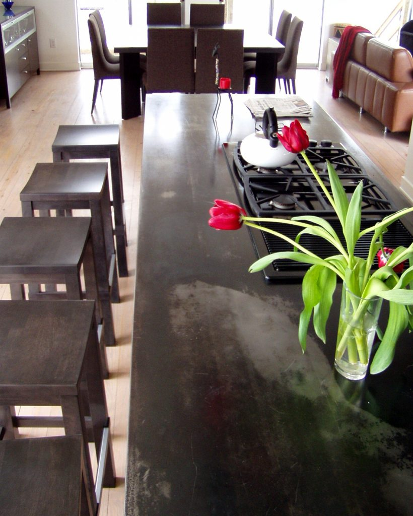 4902 Chestnut St. Bellaire TX 77401 Custom Home designed by Cameron Armstrong Architects. Unique Metal facade home with great outdoor views. Custom kitchen cabinets with black stain and steel counter-tops. Floating cabinets with vessel sinks in the master and a stained concrete shower.  Steel Counters, Metal Home, Floating cabinets, Stain kitchen cabinets, vessel sinks