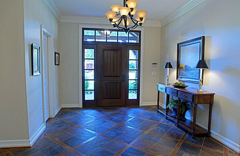 5627 Chevy Chase Dr, Houston 7756  Custom Home Remodel. Complete renovation of this 1955 Briar Grove home by Gryphon Builders.  Vaulted ceilings, Kitchen Remodel, Ceiling Beams , Stained Cabinets, Mahogany Wine Cellar, Wood inlay with tile.