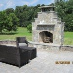 large-outdoor-living-area-using-belgart-pavers-with-stone-sitting-wall-and-natural-stone-fireplace-derwood-maryland-2