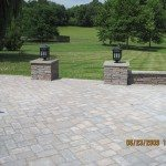 large-outdoor-living-area-using-belgart-pavers-with-stone-sitting-wall-and-natural-stone-fireplace-derwood-maryland-3