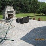 large-outdoor-living-area-using-belgart-pavers-with-stone-sitting-wall-and-natural-stone-fireplace-derwood-maryland-4